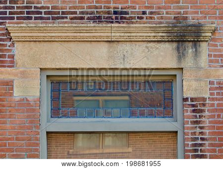 Nineteenth century window lintel made of limestone
