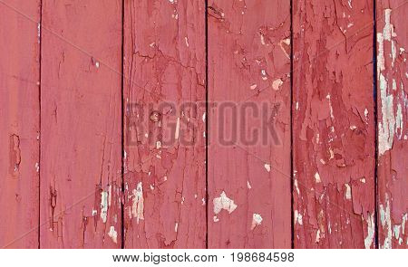 old, weathered and red Peeling Red Barn Wood