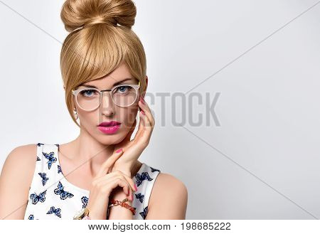 Fashion Portrait Beauty Sensual Blond Girl in Stylish glasses, Summer Outfit. Stylish Trendy Pinup hairstyle, fashion Makeup, Blue Eyes. Glamour Romantic Model in Butterfly summer Dress