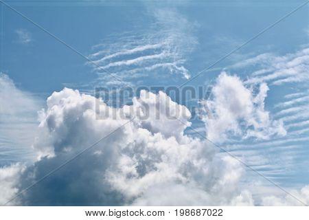 Cumulus and Altocumulus in a blue sky