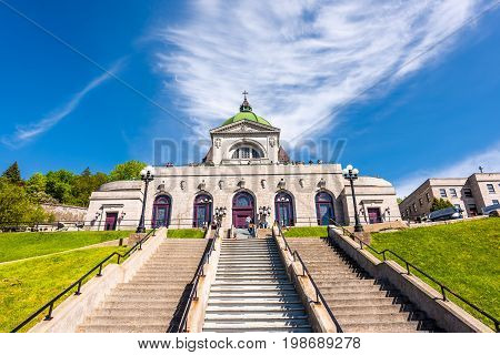 Montreal Canada - May 28 2017: St Joseph's Oratory on Mont Royal with pilgrim prayer steps in Quebec region city