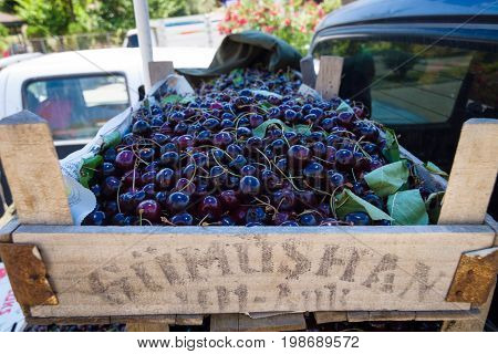 AVSALLAR TURKEY - JULY 01 2015: Boxes with fresh cherries for sale on the market (bazaar).