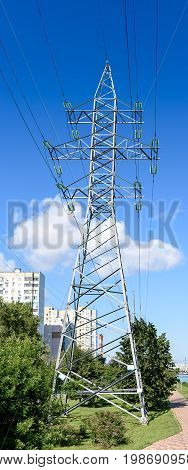 High-voltage Supports With A View Of The Blue Sky