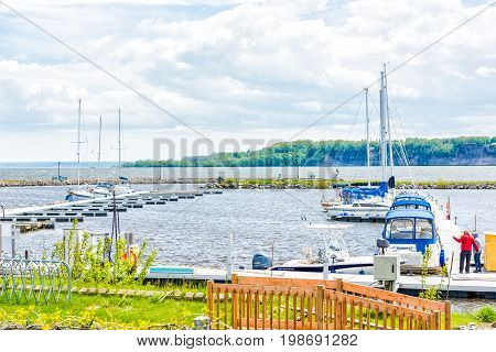 Portneuf Canada - May 29 2017: Boats on harbor by pier in Saint-Laurent or Saint Lawrence river