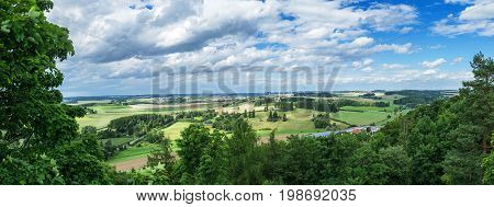 Panorama from a high altitude to a valley with fields and windmills. Hof, Bavaria, Germany