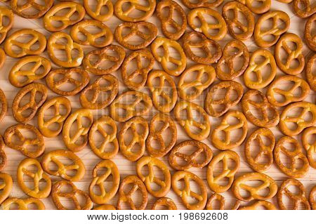 Background Texture Of Salted Savory Mini Pretzels In The Traditional Looped Knot Shape. Top View Ful