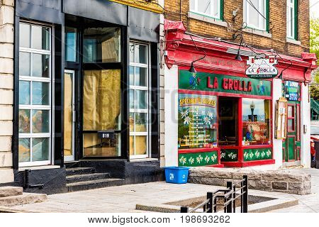 Quebec City Canada - May 29 2017: La Grolla Swiss restaurant store on street with sign and architecture in old town Saint Jean Baptiste area