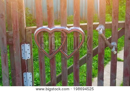 Hearts symbol on the fence of the wicket door in the village
