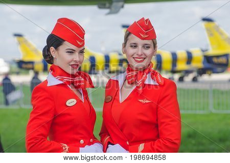 Charming Stewardess Dressed In Red Uniform. Russia, Moscow. July 2017