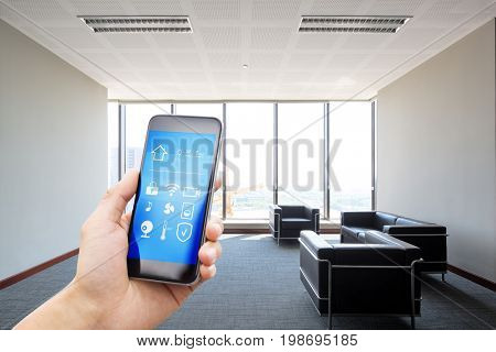 mobile phone with app on smart home in modern lobby