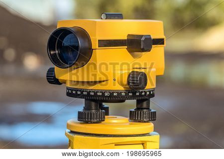 Yellow geodetic optical level. Construction engineering equipment.