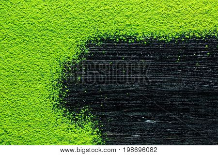 green matcha tea powder on black background image background view from above