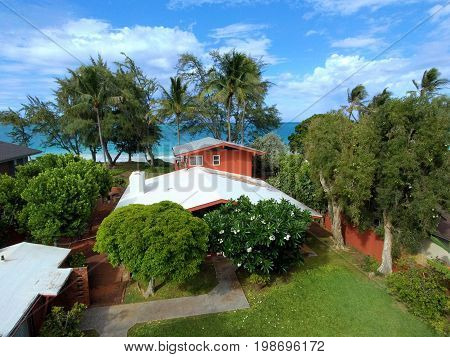 Aerial Red Beach House in Waimanalo on a Beautiful Day on Oahu Hawaii.