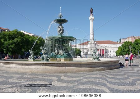 LISBON PORTUGAL - OCTOBER 14 2015: Rossio Square is the popular name of the Pedro IV Square in Lisbon Portugal. It has been one of its main squares since the Middle Ages