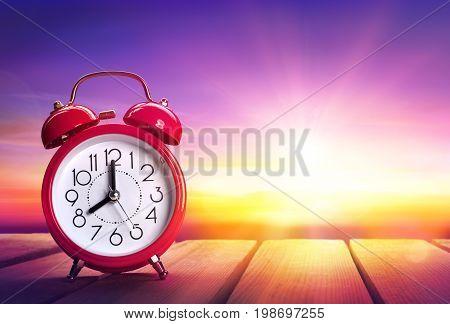 Clock Alarm At Sunrise - Waking Up Concept