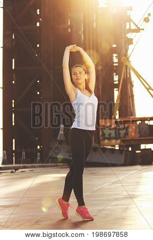Outdoor Exercising. Full-length Shot Of Attractive Young Woman In Sports Clothing Keeping Arms Raise