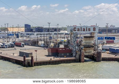 HARBOR CALAIS FRANCE - JUNE 07 2017: Port of Calais with trucks waiting for embarking at the ferry to Engeland