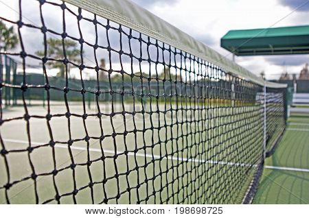 Up close view of a tennis court net on an overcast summer afternoon, Tampa, Florida, USA.