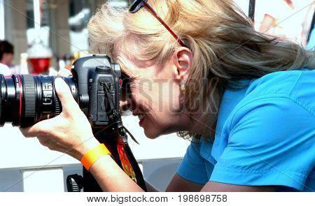 AUGUST 11, 2012. CASPER, WY: Female photographer attending a photoshoot in downtown Casper, Wy.