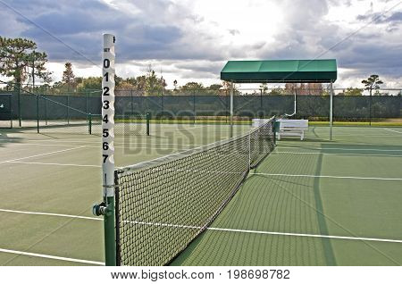 Outdoors tennis court on a sunny and cloudy afternoon. Tampa, Florida, USA.