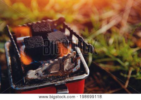 shisha hookah red hot coals On a gas burner