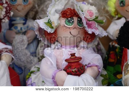 Elegant rag doll in a national suit