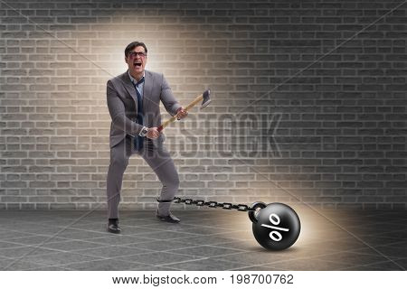 Debt concept with businessman escaping loan burden with axe