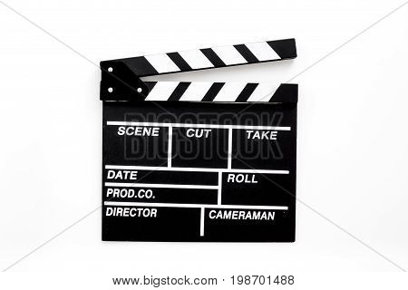 Filmmaker profession. Clapperboard on white background top view.