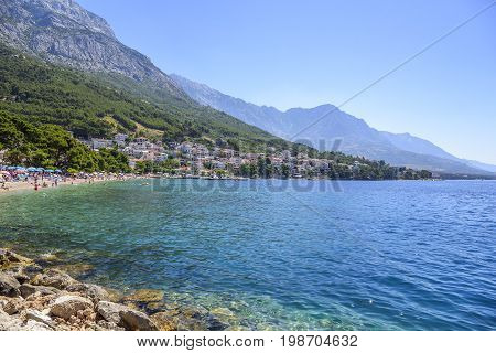 BRELA, CROATIA - 6 JULY, 2017: View of the coastline of the beaches in the resort town of Brela in Croatia.
