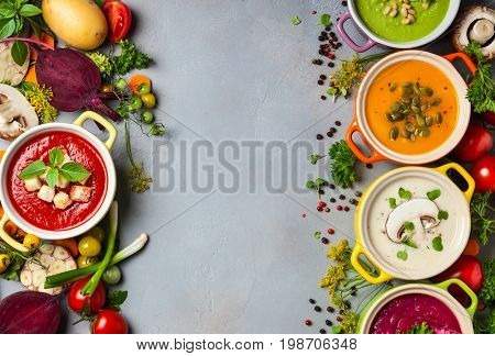 Variety of colorful vegetables cream soups and ingredients for soup. Top view. Concept of healthy eating or vegetarian food.