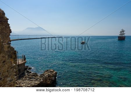 ALANYA TURKEY - JULY 04 2015: Mediterranean Sea. Traditional entertainment resort of Alanya. Sailing aka pirate ships around the fortress of Alanya.