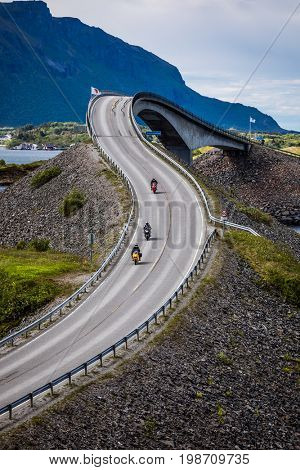 Three bikers on motorcycles. Atlantic Ocean Road or the Atlantic Road (Atlanterhavsveien) been awarded the title as
