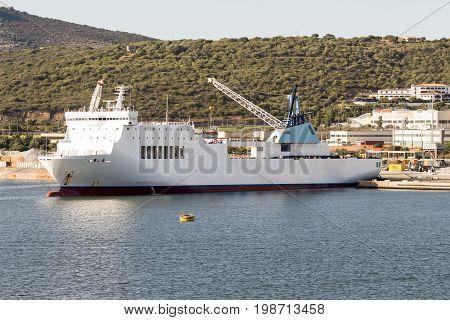 Cargo ship moored at the harbor. Olbia Italy