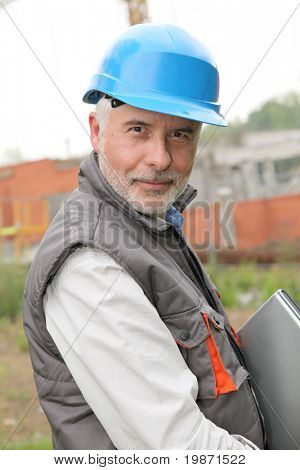 Portrait of construction manager on building site