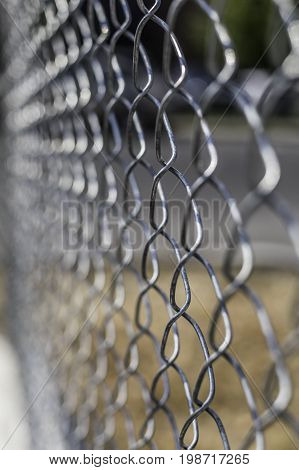 Chain link fence with shallow depth of field