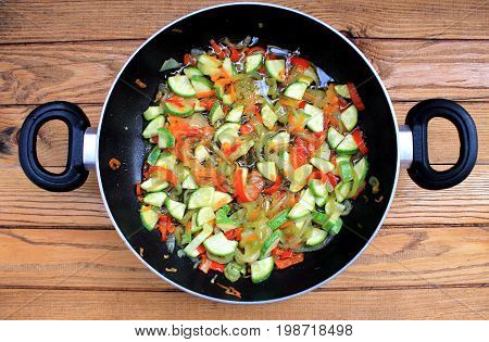 Varied vegetables stewed in a pan with non-stick coating