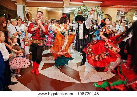 Zalishchyky, Ukraine- August 28, 2016: Gypsies Dancing And Singing On The Wedding Ceremony In Restau