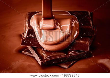 Melted flowing brown chocolate background close up