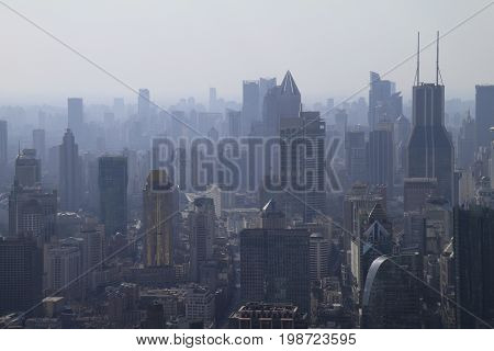 The city of Shanghai lying under a smog cloud