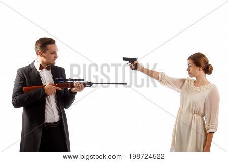 A man and a woman holding guns at each other