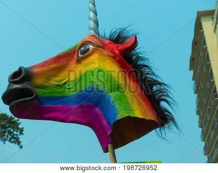 Toy horse head rainbow flag gay LGBT concept no people close up