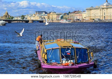 SAINT PETERSBURG/ RUSSIA - JULY 2, 2017. Motor ship on the river Neva in historical center of Saint Petersburg, Russia.