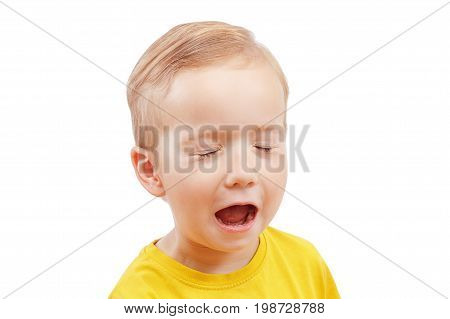 Close-up crying portrait of a little boy screaming out loud isolated on white background