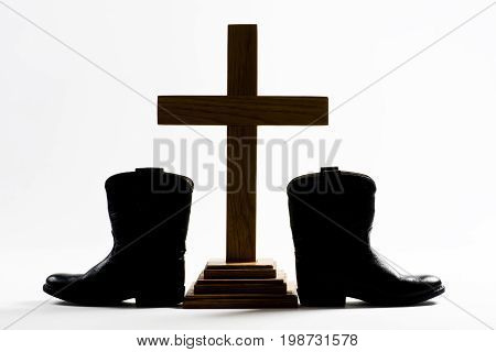 Cowboy Church with cowboy boots and Holy Cross.