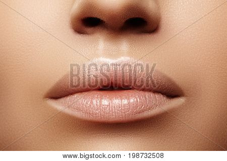 Close up plump Lips. Lip Care Augmentation Fillers. Macro photo with Face detail. Natural shape with perfect contour. Close-up perfect natural lip makeup beautiful female mouth. Plump sexy full lips