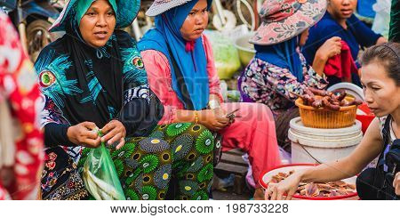 Koh Kong, Cambodia - January 3, 2017: Cambodian women sell food at the central market of Koh Kong.