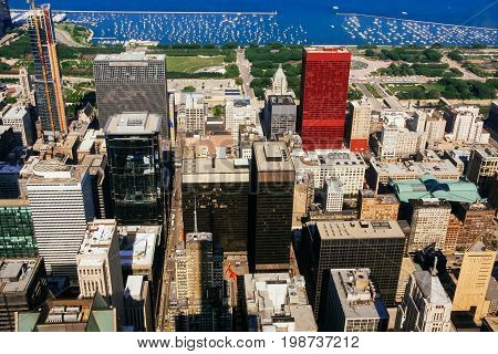 CHICAGO, USA - 20 July, 2017: A view on a day with Clouds rolling over Chicago city downtown Skyline with aerial view of buildings covered partially with clouds