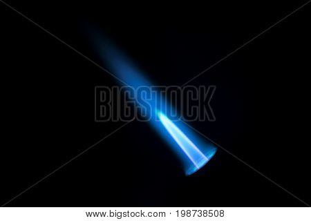 Gas burner flame. Blue fire isolated on black backgroung close-up. Macro natural