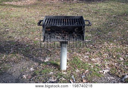 Picnickers may use a grill to cook food in the Hammel Woods Forest Preserve in Shorewood, Illinois.