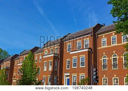 Historic red brick townhouses in Georgetown neighborhood of Washington DC USA. Historic urban architecture of US capital in spring.